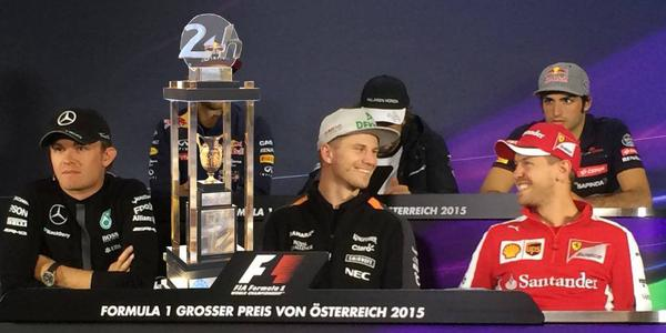 Nico Hulkenberg proudly flaunts his Le Mans trophy at the 2015 Austrian GP