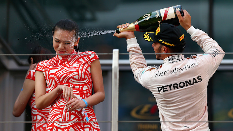 SHANGHAI, CHINA - APRIL 12:  Lewis Hamilton of Great Britain and Mercedes GP celebrates on the podium after winning the Formula One Grand Prix of China at Shanghai International Circuit on April 12, 2015 in Shanghai, China.  (Photo by Dan Istitene/Getty Images)